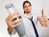 image of bartender  - Happy man bartender with shaker making alcohol cocktail drink thumb up gesture studio shot on gray - JPG
