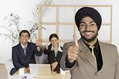image of sikh  - Sikh business executives showing thumbs up sign - JPG