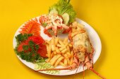 foto of lobster  - Lobster thermidor baked lobster served with shrimp cocktail and French fries - JPG
