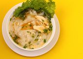 picture of glass noodles  - Glass noodle soup with chicken and beansprouts on a yellow background - JPG