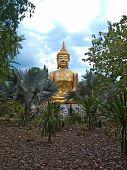 stock photo of kan  - Statue of Buddha in Wang Kan Lueang Waterfall - JPG