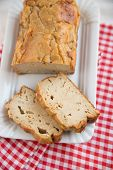 image of home-made bread  - Home made Sliced Banana Bread on a table - JPG