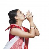 image of bengali  - Traditional Bengali woman blowing shankha - JPG