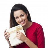 pic of salwar  - Portrait of a happy woman holding a gift box - JPG