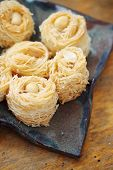 image of baklava  - Eastern dessert baklava honey with nuts on a plate - JPG