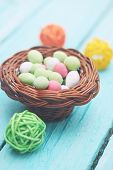 stock photo of easter candy  - Small round basket with candy Easter dessert - JPG