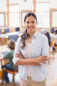 image of teachers  - Pretty teacher smiling at camera at back of classroom at the elementary school - JPG