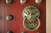 image of lions-head  - massive lion head door handle at the Buddhist temple in Singapore - JPG
