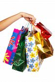 stock photo of holding money  - Christmas shopping bags isolated over white backgrond - JPG
