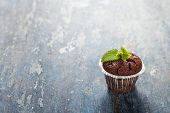 stock photo of chocolate muffin  - Chocolate muffins on wooden board  - JPG