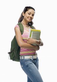 pic of x-files  - Portrait of a female college student holding files - JPG