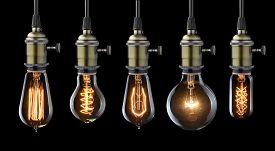 foto of reflections  - Set of vintage glowing light bulbs on black - JPG
