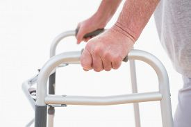 picture of zimmer frame  - Senior man walking with zimmer frame - JPG