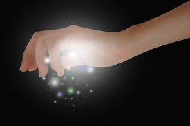 pic of tinkerbell  - A hand releasing magic dust in the air - JPG