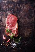 image of ribeye steak  - Raw fresh meat Steak Ribeye and seasonings on dark metal background - JPG