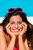 pic of sunbather  - Funny woman with sunscreen lotion in her nose sunbathing and enjoying summer at swimming pool - JPG