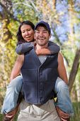 stock photo of american indian  - Happy young couple in fall forest - JPG