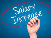 image of employee month  - Man Hand writing Salary Increase with black marker on visual screen - JPG