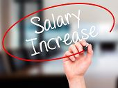 stock photo of employee month  - Man Hand writing Salary Increase with black marker on visual screen - JPG