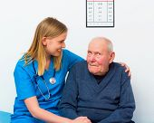 foto of geriatric  - Geriatric doctor taking care of elderly man with dementia - JPG