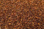 stock photo of fynbos  - Fermented Rooibos or redbush tea leaves background - JPG