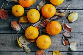 Fresh Mandarin Oranges Fruit With Leaves On Wooden Table.  Ripe poster