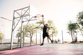 Photo of basketball player practicing and posing for basketball and sports athlete concept. Looking  poster