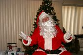 picture of 24th  - Santa relaxes by a xmas tree - JPG