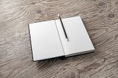 Mockup Of Opened Blank Book And Pencil On Wood Table Background. Responsive Design Mockup. poster