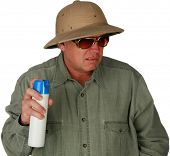 a man sprays bug spray or air freshener