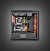 Open Computer With Red Lighting Effects And Water Cooled Cooling System On Black Gradient Background poster