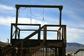 stock photo of gallows  - a gallows in a real ghost town in nevada usa with two nooses bringing to light the reality of Swift Justice from the Wild Wild West - JPG