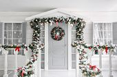 Christmas Morning. Porch A Small House With A Decorated Door With A Christmas Wreath. Winter Fairy T poster