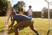 Four black adult friends having a fun game of football poster