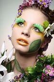 Постер, плакат: Портрет красивая фотомодель носить костюм изготовлен из цветов