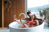 Couple Enjoying A Bath With Champagne poster
