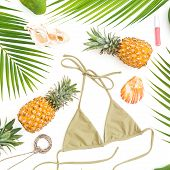 Tropics Concept. Pineapples, Mango Fruits With Bikini Swimwear On White Background. Flat Lay, Top Vi poster