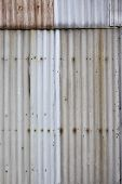 Ugly corrugated iron metal background texture.