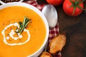 Homemade Butternut Squash Soup With Rosemary Herbs And Toppings. Hot  Pumpkin Cream-soup In A White  poster