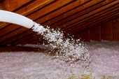 Spraying Blown Fiberglass Insulation For Roof Technician Spraying Foam Insulation Using Plural Compo poster