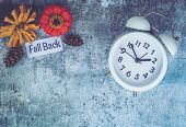 Fall Daylight Saving Time Concept With White Clock And Flowers, Flat Lay poster