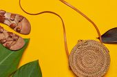 Fashionable Handmade Natural Organic Rattan Bag, Leather Sandals, Tropical Leaves On Bright Yellow M poster