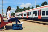 Traveller Girl With Travel Bag At Train Station Travel And Transportation Concept poster
