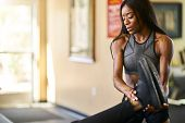 personal trainer helping woman stretch in gym poster