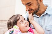 Closeup Portrait Of Handsome Happy Young Father Embrace His Daughter After Preschool Day. Cute Littl poster
