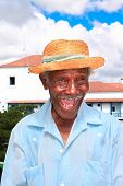 Old sympathetic cuban man with straw hat make a funny face, Santiago de Cuba, Cuba