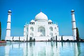 foto of mausoleum  - World wonder Taj Mahal in soft daily light with clear blue sky - JPG