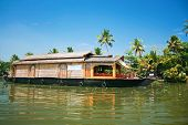 stock photo of houseboats  - Exciting journey with a houseboat through the backwaters in Kerala - JPG
