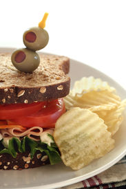 foto of potato chips  - Bologna Cheese Lettuce and Tomato Sandwich with Potato Chips - JPG