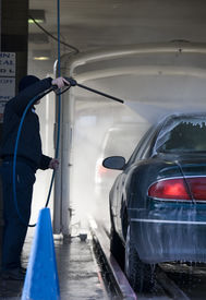 pic of car wash  - Automobile going through the car wash to be washed - JPG